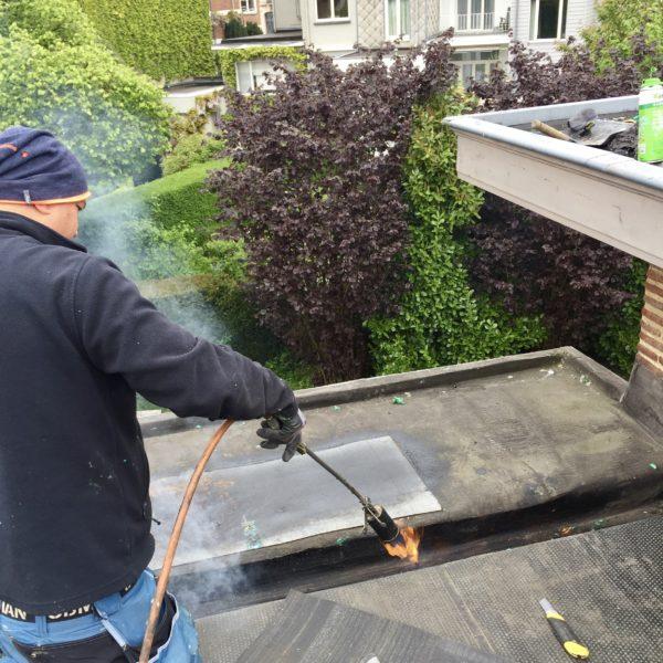 Toiture plate réparation Bruxelles